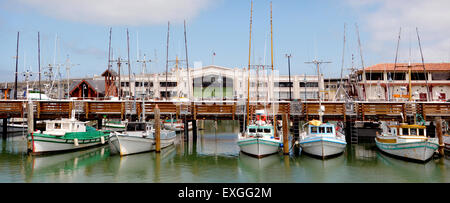 Panoramic view of a line of fishing boats in Fisherman Wharf, San Francisco CA. - Stock Photo