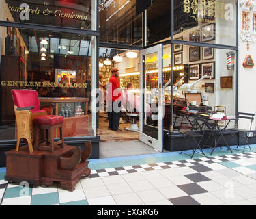 Interior of Barton Arcade a victorian shopping centre on Deansgate and St. Annes Square in Manchester UK, showing - Stock Photo