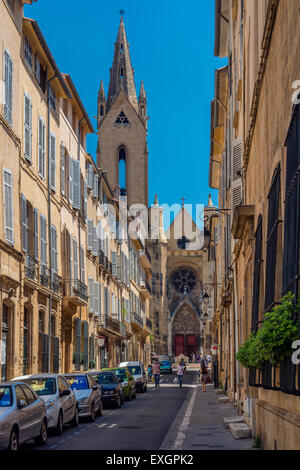 Street in the historical Quartier Mazarin district with St. Jean de Malte church in the background, Aix-en-Provence, - Stock Photo