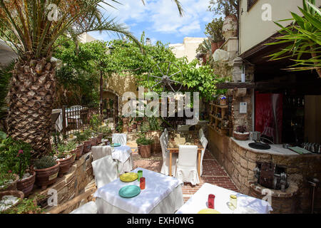 One of the top end Greek restaurants in Rethymnon, the Avli is without doubt a great eating experience for all visitors. - Stock Photo