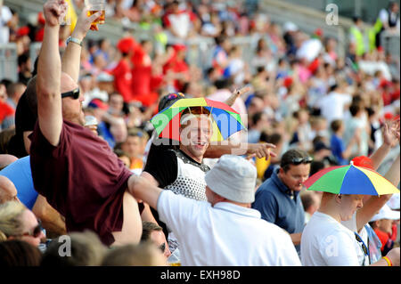 Fans celebrating in the crowd at Emirates Old Trafford, Manchester, England. T20 Blast cricket match Lancashire - Stock Photo