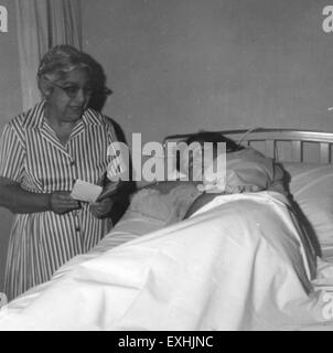 Mercedes Melendez visiting hospital patient, 1964 1 - Stock Photo