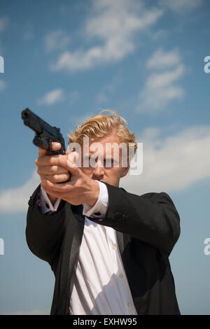 man pointing a gun and aiming to shoot someone Stock Photo ...