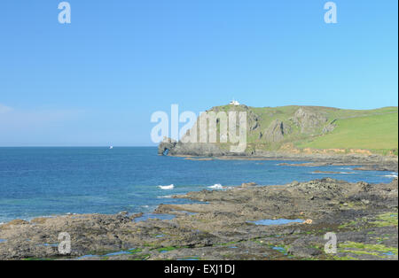 Distant View of East Prawle Lighthouse on the South West Coastal Path, near Salcombe, on the South Devon Coast, - Stock Photo