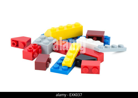 Close-up of pile of colorful Lego pieces isolated on white background - Stock Photo