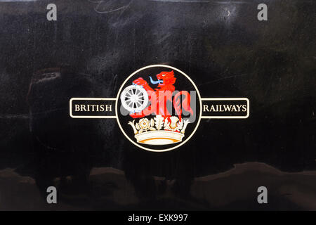 British Railways rampant lion and wheel insignia on the side of standard 4 tank steam engine 80080. - Stock Photo