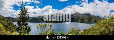 Panoramic view of Laguna de Cuicocha, a volcanic crater lake, and Cotacachi Volcano. Cotacachi, Ecuador. - Stock Photo