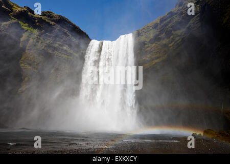 double rainbow at skogafoss waterfall in iceland - Stock Photo