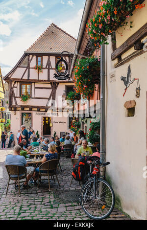 Le Medieval, outdoor cafe and street scene, Riquewihr, Alsace, France - Stock Photo