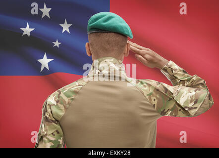 Dark-skinned soldier in hat facing national flag series - Samoa - Stock Photo
