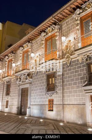 GRANADA, SPAIN - MAY 29, 2015: The facade of Palacio de la Madraza (Madrasah of Granada) at night. - Stock Photo