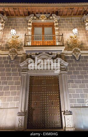 GRANADA, SPAIN - MAY 29, 2015: The portal of Palacio de la Madraza (Madrasah of Granada) at night. - Stock Photo