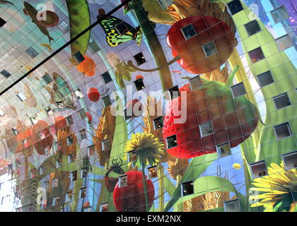 Colourful interior of the Rotterdam Markthal (Rotterdam Market hall).  Artwork by Arno Coenen - Cornucopia, Hoorn - Stock Photo
