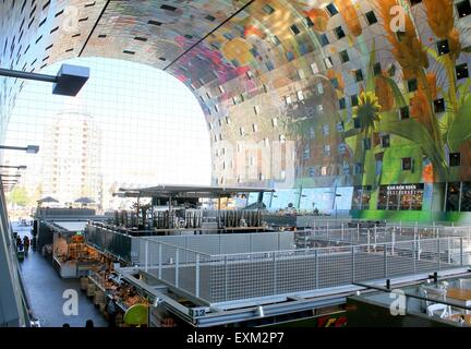 Colourful interior and ceiling of the Rotterdamse Markthal (Rotterdam Market hall), at Blaak square. - Stock Photo