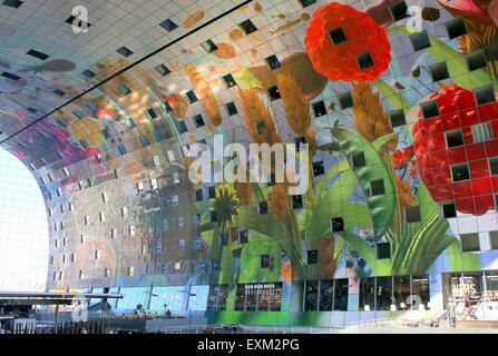 Colourful interior of the Rotterdamse Markthal (Rotterdam Market hall) at Blaak square. Artwork by Arno Coenen  - Stock Photo