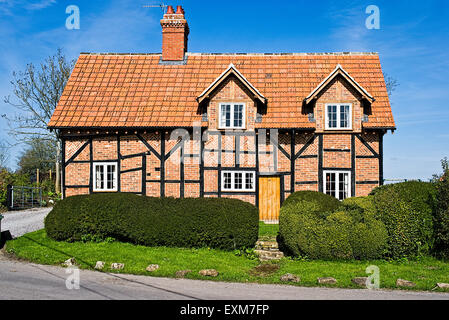 Brick and tile cottage in Great Hinton near Trowbridge Wiltshire UK - Stock Photo