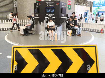 Shanghai, China. 15th July, 2015. Spectators experience virtual reality devices at Mobile World Congress (MWC) with the theme of Mobile Infinity in Shanghai, east China, July 15, 2015. © Ding Ting/Xinhua/Alamy Live News Stock Photo