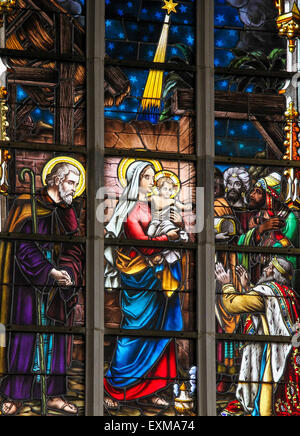 Stained Glass depicting the Three Kings visiting the infant Jesus in the Church of Haacht, Belgium - Stock Photo