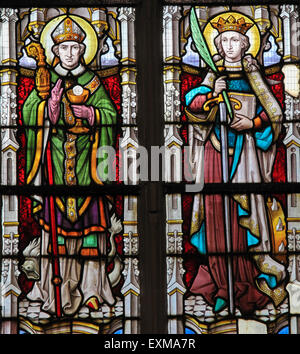 Stained glass window depicting two Catholic Saints, including Saint Catherine on the right - Stock Photo