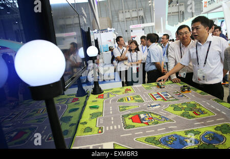Shanghai, China. 15th July, 2015. Spectators view an equipment of Internet of Things at Mobile World Congress (MWC) with the theme of Mobile Infinity in Shanghai, east China, July 15, 2015. © Pei Xin/Xinhua/Alamy Live News Stock Photo