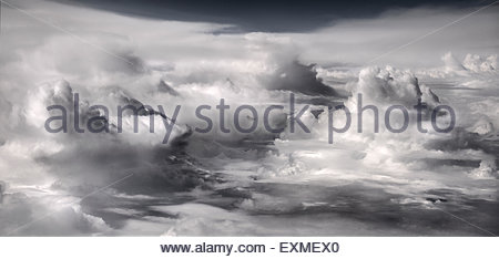 Aerial view from an aircraft - cumulus clouds. - Stock Photo