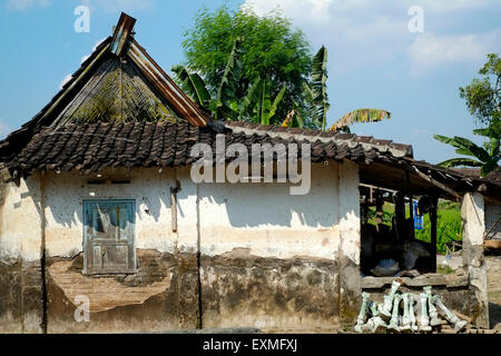 typical run down rural village house in java indonesia - Stock Photo