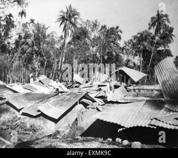 Houses damaged by the Hindu Muslim riots in Noakhali East Bengal ; November 1946 ; India - Stock Photo