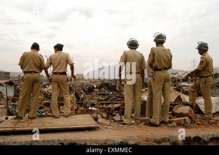 Police constables keep watch to prevent any untoward incidents demolition illegal slums Mankhurd Link Road Mumbai