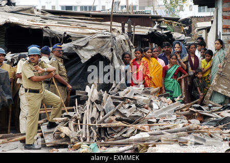 Police constables keep watch to prevent any untoward incidents demolition of illegal slums Mankhurd Link Road Mumbai