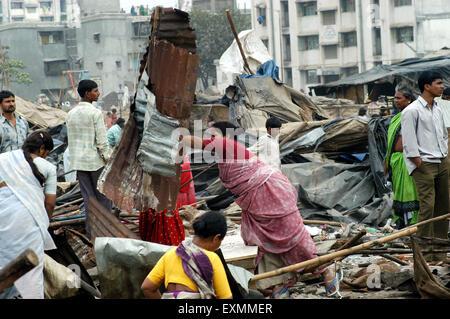 Slum dwellers remove their belongings demolition of illegal slums Mankhurd Link Road Mumbai