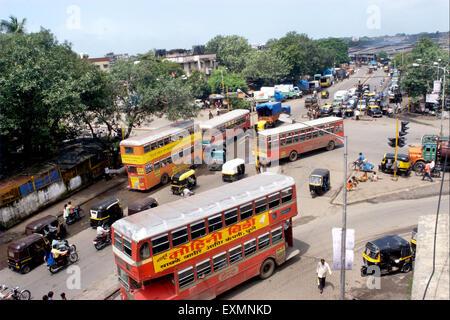 BEST buses Auto rickshaws bikes traffic main junction roundabout Lal Bahadur Shastri Marg Kurla Mumbai Maharashtra - Stock Photo
