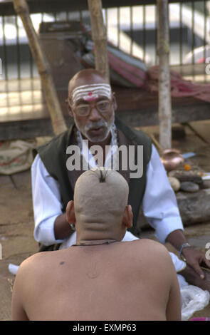 bald man sadhu Varanasi Uttar Pradesh India - Stock Photo