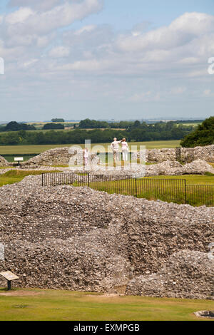 Visitors exploring at Old Sarum, near Salisbury, Wiltshire in July - Stock Photo