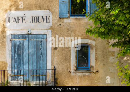 Facade of an old house with painted shop sign in Aurel, Provence, France - Stock Photo