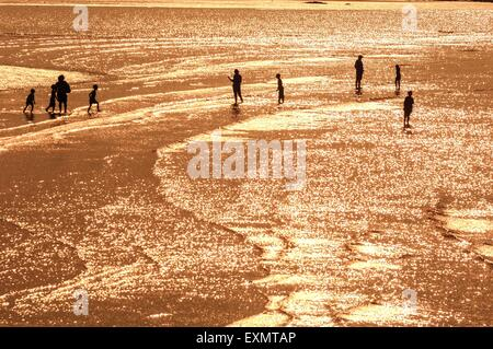 Holidaymakers paddling in the sea at low tide. Margate. Kent. UK - Stock Photo