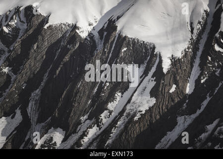 Snow capped, rocky mountains, French Alps. - Stock Photo