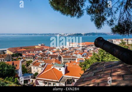 Portugal, Lisbon, a cannon at Castelo de Sao Jorge overlooking the Baixa Pombaline, the Pombaline Downtown of Lisbon - Stock Photo
