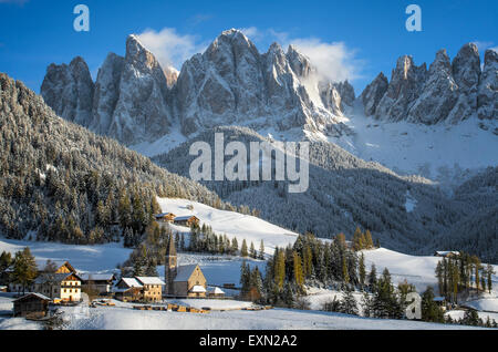 The small village of St. Magdalena or Santa Maddalena with its church covered in snow and with the Odle or Geisler - Stock Photo
