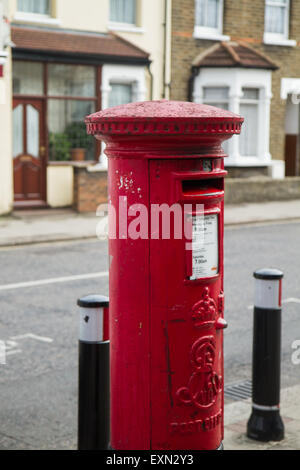 London, UK. 15th July 2015. Red post boxes seen in Ilford's neighbourhood (part of the London Borough of Redbridge) - Stock Photo
