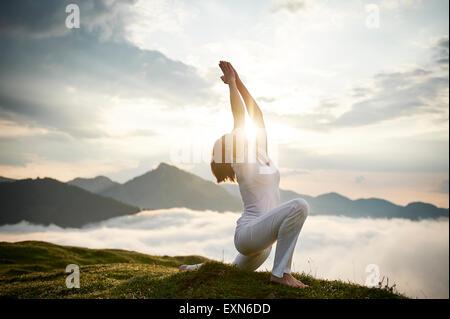 one caucasian woman sun salutation yoga surya namaskar
