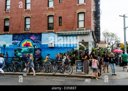Brooklyn, NY 12 July 2015 - The busy Bedford Avenue subway station in Williamsburg Brooklyn - Stock Photo