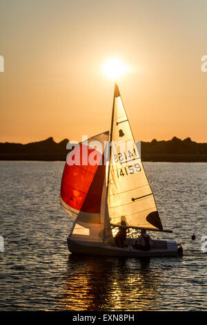 Southport, Merseyside, UK 15th July, 2015. UK Weather. Calm sunny end to St Swithin's day as evening sailors, from - Stock Photo