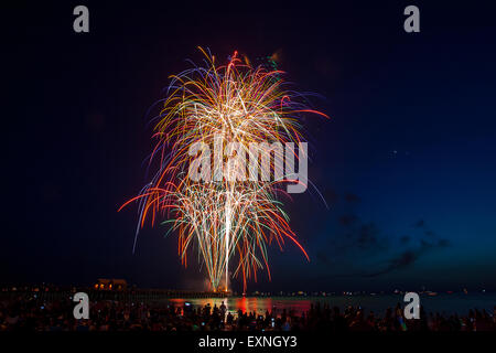 Fireworks display over the Naples Florida Pier near Marco Island and Fort Myers - Stock Photo