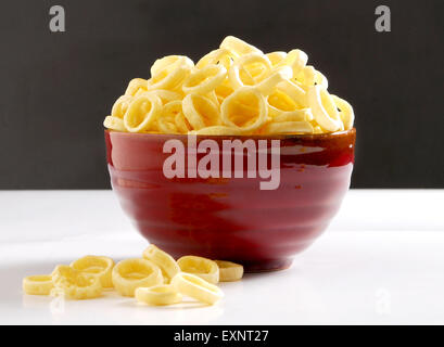 Corn Ring Snacks in Red Bowl - Stock Photo
