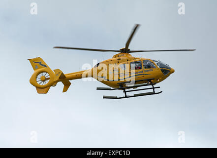 Eurocopter EC135T-1 G-SASA Departing Inverness Dalcross Airport Base on callout.  SCO 9959. - Stock Photo