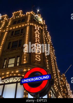 Knightsbridge, London, England. Harrods lights and Underground sign. - Stock Photo