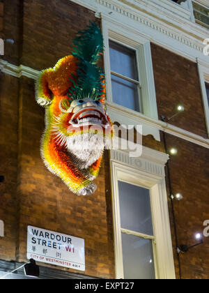 China Town, London, England. Chinese New Year dragon on the wall in Wardour street, Soho. - Stock Photo