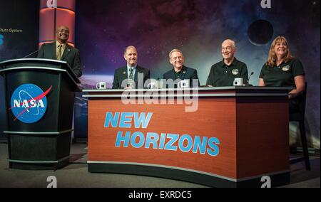 NASA Senior Public Affairs Officer Dwayne Brown, left, moderates a New Horizons mission briefing with Associate - Stock Photo