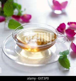 Rose lemon tea in glass cup, close-up - Stock Photo