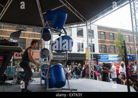 London, UK. 16th July 2015. Ben Walsh performs during 'The Streets' community cultural event as it launches in Ilford, - Stock Photo